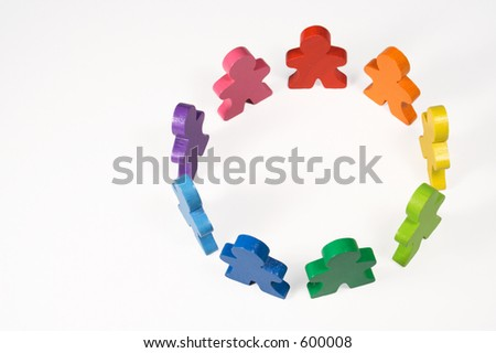 Diversity and Teamwork - Colorful toy people standing in a circle.