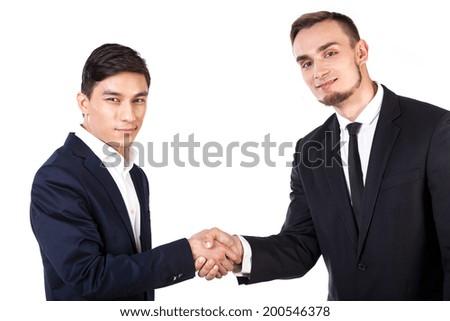 Diversity business handshake on white isolated background - stock photo