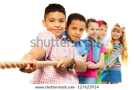 Diversity kids boys and girls buplling the rope isolated on white - stock photo