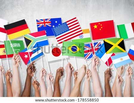 Diversity of Hands Holding National Flags - stock photo