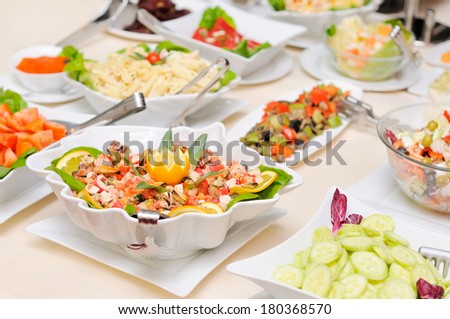 Diversity of salads on the table - stock photo
