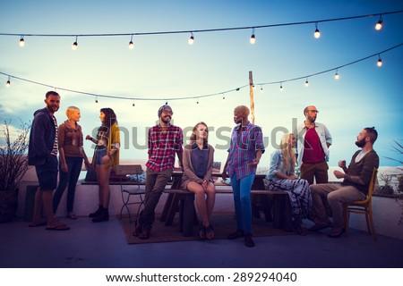 Diversity Sundown Beach Chatting Roof Top Fun Concept - stock photo