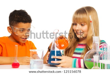 Diversity team black teen boy and blond Caucasian girl in the school chemistry class, isolated on white - stock photo