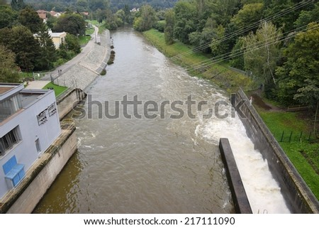 Diverted water at the dam. Flooding and heavy rain in the Czech Republic, Brno. - stock photo