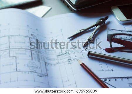 Divider pencil pen ruler glasses smartphone stock photo download divider pencil pen ruler glasses and smartphone and blueprint on table top malvernweather Image collections