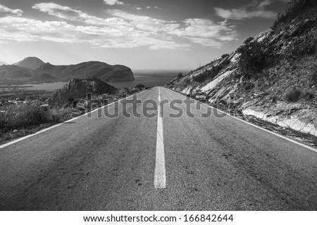 Dividing line, coastal mountain highway in Montenegro - stock photo