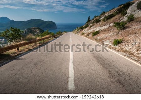 Dividing line on the coastal mountain highway in Montenegro - stock photo