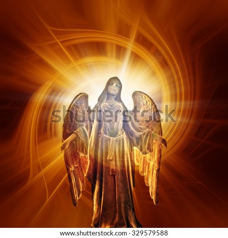 divine angel statue with rays of light coming from behind - stock photo