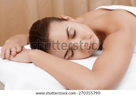 Divine pleasure. Beautiful young woman relaxing with hand massage at beauty spa