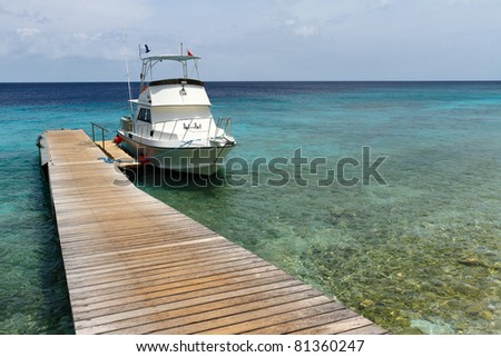 Diving boat at a pontoon in Curacao - stock photo