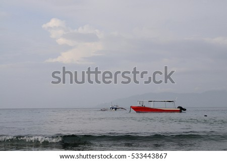 Diving boats anchored in a tranquil harbour, Puerto Galera, Philippines