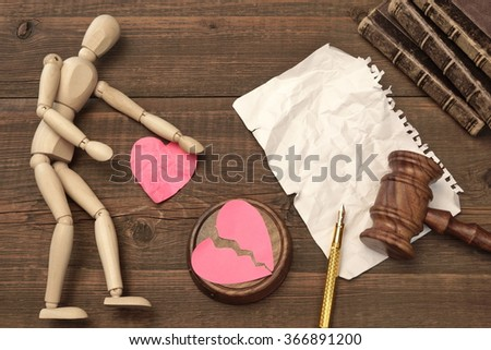 Divorce Concept In The Court. Gavel, Law Book, Judges Gavel, Empty White Page, Broken Paper Heart On Wood Background - stock photo