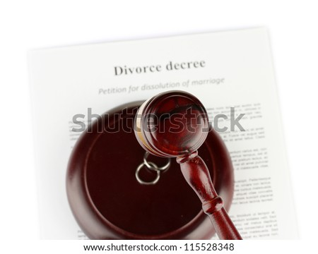 Divorce decree and wooden gavel on white background - stock photo