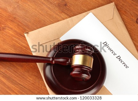 Divorce decree and wooden gavel on wooden background - stock photo