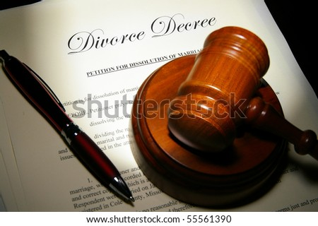 Divorce papers and pen with judge's legal gavel - stock photo