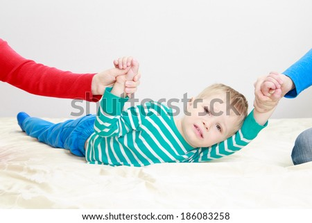 divorced parents holding sad child separately - stock photo