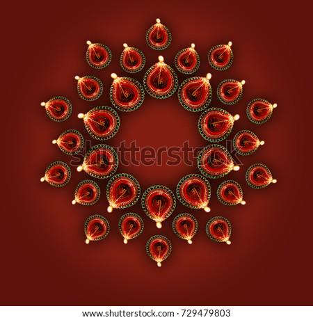 Diwali greeting card showing top view stock photo 729479803 diwali greeting card showing top view of illuminated diya or oil lamp or panti forming a m4hsunfo