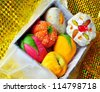 Diwali mithai, Box of colorful sweets made of milk, sugar and nuts. - stock photo