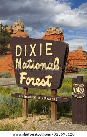 DIXIE NATIONAL PARK, UT, SEPTEMBER 7: Dixie National Forest sign along the road. In the background a beautiful red rock formation. USA 2012