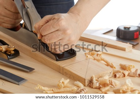 DIY concept. Woodworking and crafts tools. Carpentry hand tools. Planers, chisels, saw, measuring tools. Craftsman makes a wooden parts. Wooden background. Isolated on white