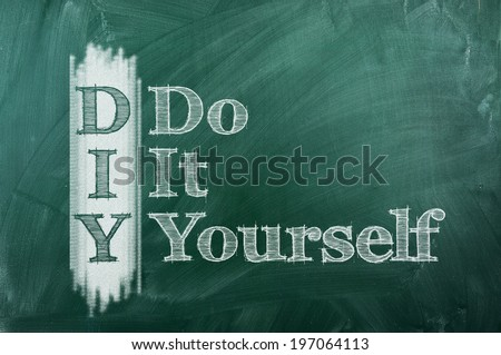 DIY -  Do It Yourself acronym on green chalkboard