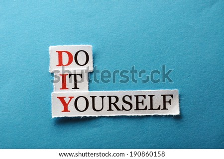 DIY Do It Yourself, words on cut paper hard light - stock photo