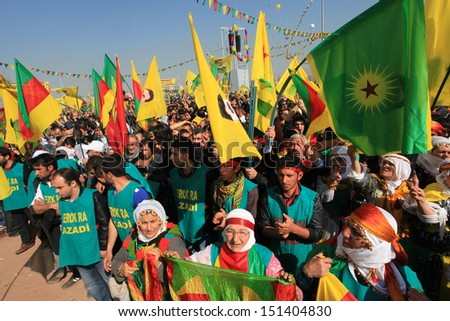 DIYARBAKIR,TURKEY - MARCH 21: Kurds celebrating their traditional feast Newroz that means 'new day' in kurdish on March 21, 2013 in Diyarbakir, Turkey. - stock photo