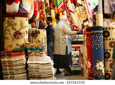 DIYARBAKIR, TURKEY � SEPTEMBER 28: Kurdish people shopping at Diyarbakir Old Covered Bazaar on September 28, 2009 in Diyarbakir, Turkey. Diyarbakir is one of the largest cities in southeastern Turkey. - stock photo