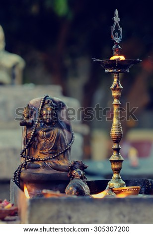 Diyas offered to Lord Shiva in Shivaratri or great night of Shiva at Hindu temple. Shivaratri is a Hindu festival celebrated annually on the day Shiva was married to the goddess Parvati. - stock photo