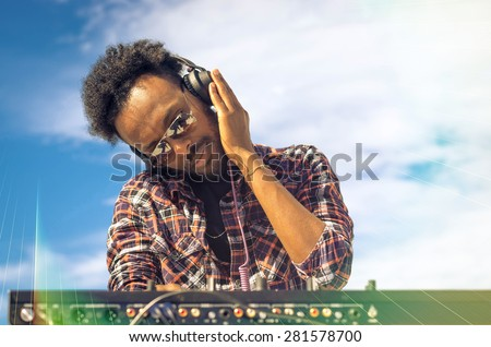 dj adult plays with its equipment - lifestyle concept  - stock photo