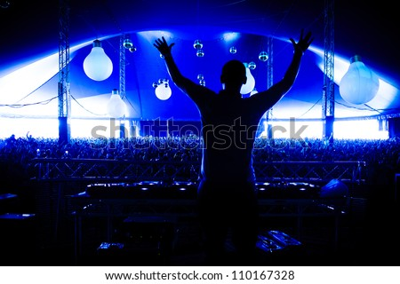 DJ Afrojack Silhouette With Crowd at Creamfields Festival - stock photo