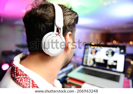 DJ at a corporate party - stock photo