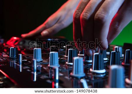 DJ at work. Close-up of DJ�¯�¿�½ hands making music - stock photo