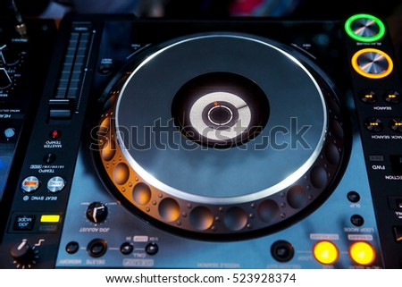 DJ CD player and mixer in a nightclub in daylight on outdoor party