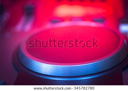 DJ console cd mp4 deejay mixing desk Ibiza house techno dance music wedding reception party in nightclub with colored lighting effect disco lights. - stock photo