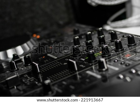 DJ drives buttons in black and white
