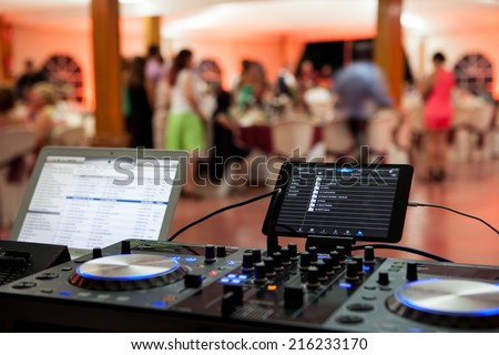 dj equipment in a party with short deep of field - stock photo
