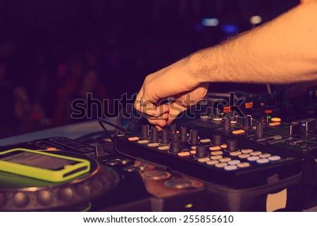 DJ hands on the remote. nightclub - stock photo
