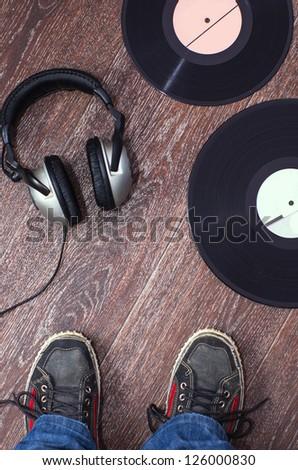 dj headphones and vintage vinyl - stock photo