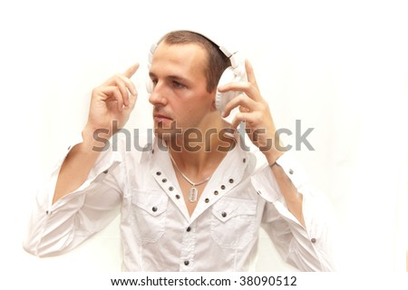 dj in white dances to his music - stock photo
