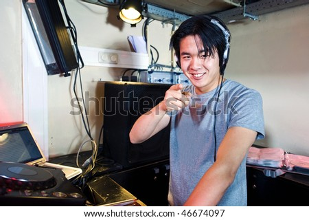 DJ looking and pointing his finger at the viewer. - stock photo