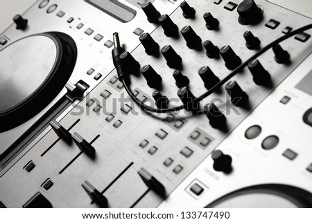 Dj mixer equipment to control sound and play music - stock photo