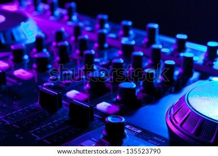 dj mixer in a night club - stock photo