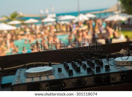 DJ mixer on pool party - stock photo