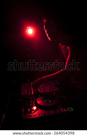 Dj mixer with headphones at nightclub light - stock photo
