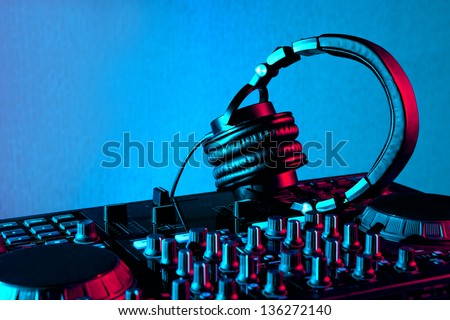dj mixer with headphones at nightclub party - stock photo