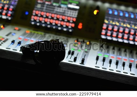 Dj mixes the track in the nightclub at a party  - stock photo