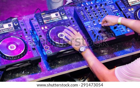 Dj mixes the track in the nightclub at party. Top view - stock photo