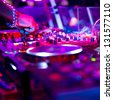 Dj mixing in nightclub at party. - stock photo