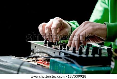 DJ mixing tape isolated on black background  - stock photo
